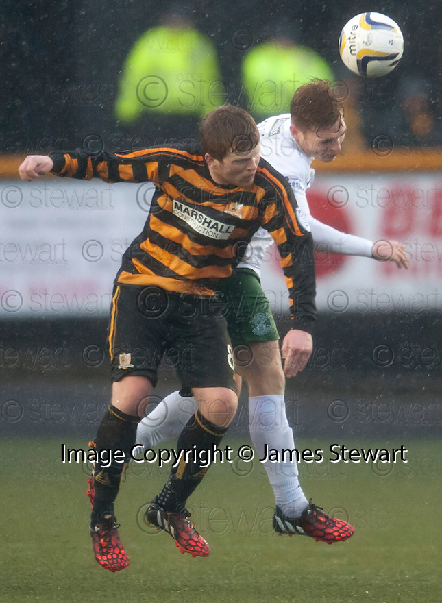 Alloa's Ryan McCord and Hib's Fraser Fyvie challenge for the ball.