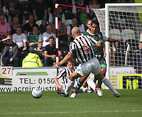 Jorge Claros beats Jim Goodwin in the St Mirren v Hibernian Clydesdale Bank Scottish Premier League match played at St Mirren Park, Paisley on 18.8.12.