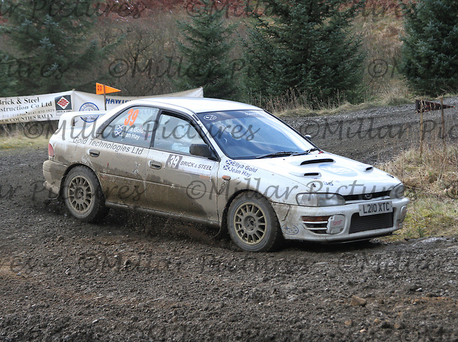 Ellya Gold - Jean Hay in a Subaru Impreza at Junction 8 on Special Stage 5 Buck Fell on the Brick & Steel Border Counties Rally 2014, Round 2 of the RAC MSA Scottish Rally Championship sponsored by ARR Craib Transport Limited and other championships  and organised by Whickham & District and Hawick & Border Car Clubs and based in Jedburgh and held in Kielder Forest on 22.3.14.