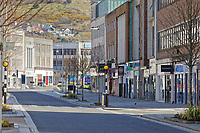 Pictured: The Kingsway, one of the busiest central roads, is deserted in Swansea, Wales, UK. Sunday 22 March 2020<br /> Re: Covid-19 Coronavirus pandemic, UK.