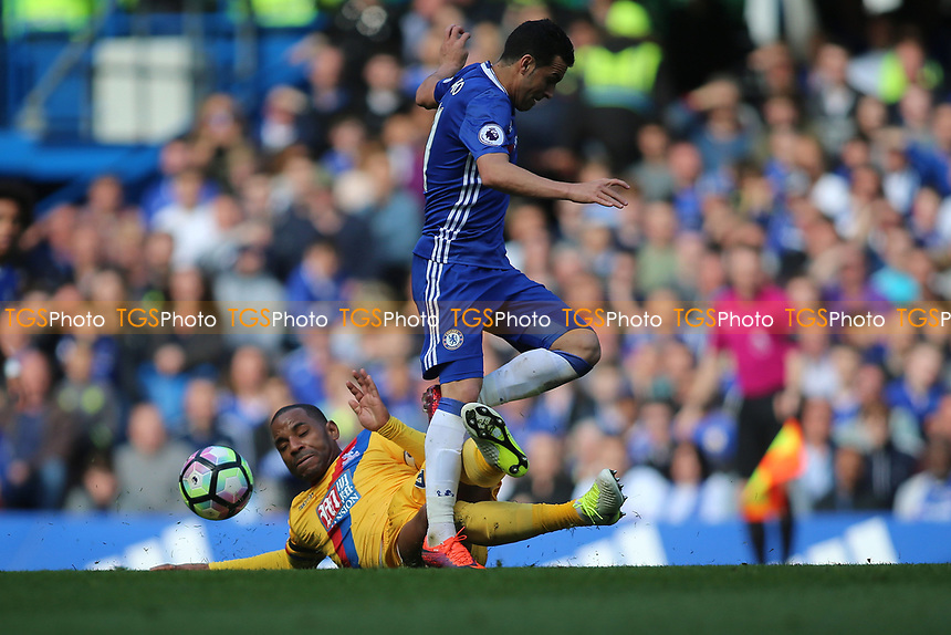 Jason Puncheon of Crystal Palace tackles Pedro of Chelsea  during Chelsea vs Crystal Palace, Premier League Football at Stamford Bridge on 1st April 2017