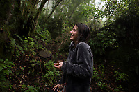 "Adriana Quiroz after a Temazcal (sweat lodge session) with a cup of ""Derrumbe"" magic mushroom tea enjoys wondering through Navarro's forest . Shaman Navarro offers temazcal (Sweat lodge) and medicinal muchroom therapies. San Jose del Pacifico, Oaxacan Sierra Sur, Oaxaca, Mexico"