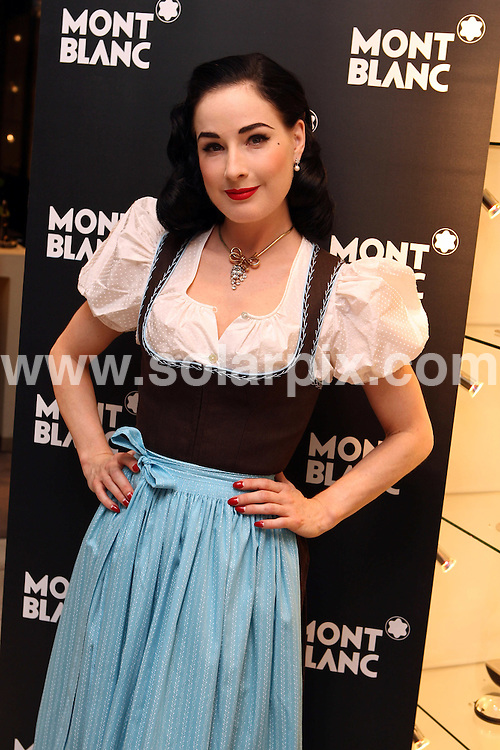 **ALL ROUND PICTURES FROM SOLARPIX.COM**.**SYNDICATION RIGHTS FOR UK AND SPAIN ONLY**.Dita von Teese visits the Mont Blanc Store at the Old Market in Salzburg, Austria. 29 July 2009.This pic: Dita von Teese..JOB REF: 9632 CPR (Neumayr) DATE: 29_07_2009.**MUST CREDIT SOLARPIX.COM OR DOUBLE FEE WILL BE CHARGED**.**MUST NOTIFY SOLARPIX OF ONLINE USAGE**.**CALL US ON: +34 952 811 768 or LOW RATE FROM UK 0844 617 7637**