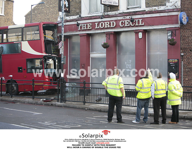 ALL ROUND  PICTURES BY SOLARPIX.COM.**NO PUBLICATION IN FRANCE, SCANDANAVIA, AUSTRALIA AND GERMANY** NO UK NEWSPAPER PUBLICATION - UK MAGAZINES ONLY**.A number 253 London bus crashed into a pub in Clapton , East London early this morning.It's believed the bus driver crashed after swerving to avoid another bus..JOB REF SFE 2866 2.10.06.