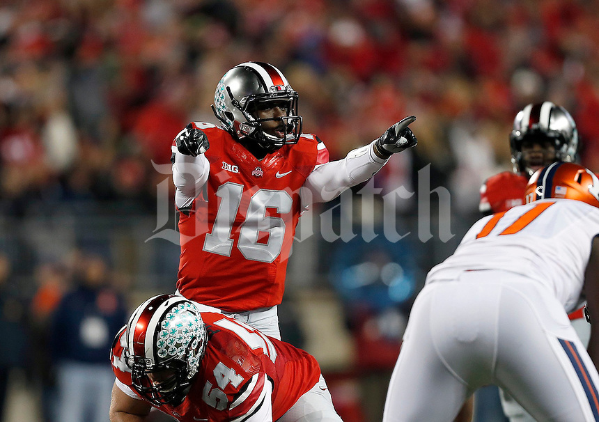 Ohio State Buckeyes quarterback J.T. Barrett (16) looks over the defense in the first quarter of the NCAA football game at Ohio Stadium on Saturday, November 1, 2014. (Columbus Dispatch photo by Jonathan Quilter)