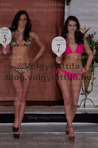 Lilla Szandra Gajdacs (L) and Antonia Csehi (R) participate the Miss Hungary beauty contest held in Budapest, Hungary on December 29, 2011. ATTILA VOLGYI