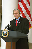 United States President George W. Bush makes remarks as he pardons Katie the turkey at the annual turkey pardoning ceremony in the Rose Garden of the White House in Washington, DC on 26 November, 2002.<br /> Credit: Ron Sachs / CNP