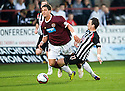 HEARTS' RUDI SKACEL IS BROUGHT DOWN BY PARS DAVID GRAHAM