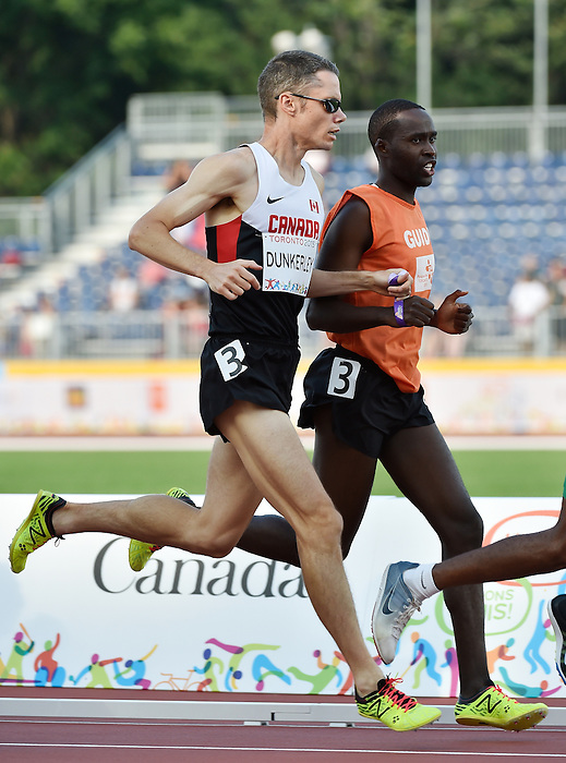 Toronto, ON - Aug 14 2015 - Jason Dunkerley and his guide Josh Karanja competes in the Men's 1500m T11 Final in the CIBC Athletics Stadium during the Toronto 2015 Parapan American Games  (Photo: Matthew Murnaghan/Canadian Paralympic Committee)