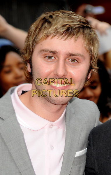 "Jame Buckley .""The Inbetweeners Movie"" UK premiere, Vue West End cinema, Leicester Square, London, England..August 16th, 2011.headshot portrait grey gray jacket pink shirt.CAP/WIZ.© Wizard/Capital Pictures."
