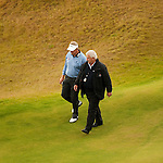 Colin Montgomerie is told by Chief Referee, John Paramor that play will not resume as planned as the course is still unplayable in places during the second round  of the Barclays Scottish Open, played over the links at Castle Stuart, Inverness, Scotland from 7th to 10th July 2011:  Picture Stuart Adams /www.golffile.ie 9th July 2011