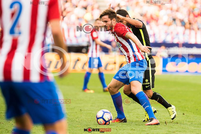 Atletico de Madrid's player Saul Ñiguez and Sporting de Gijon's player Victor R. during a match of La Liga Santander at Vicente Calderon Stadium in Madrid. September 17, Spain. 2016. (ALTERPHOTOS/BorjaB.Hojas) /NORTEPHOTO