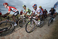 polka dot jersey Joaquim Rodriguez (ESP/Katusha) on the cobbled sector of Artres (1200m)<br /> <br /> stage 4: Seraing (BEL) - Cambrai (FR) <br /> 2015 Tour de France