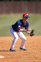 Ryan McMillen (10) of the Shippensburg Raiders takes infield practice prior to the game against the Belmont Abbey Crusaders at Abbey Yard on February 8, 2015 in Belmont, North Carolina.  The Raiders defeated the Crusaders 14-0.  (Brian Westerholt/Four Seam Images)
