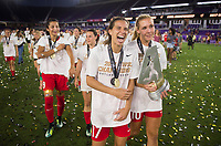 Orlando, FL - Saturday October 14, 2017: Tobin Heath, Allie Long and theNWSL Trophy during the NWSL Championship match between the North Carolina Courage and the Portland Thorns FC at Orlando City Stadium.   The Portland Thorns won the championship, 1-0.