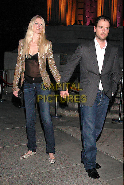 CLAUDIA SCHIFFER & MATTHEW VAUGHN.Arrivals at the annual Vanity Fair Party to celebrate the Tribeca Film Festival at the State Supreme Court in downtown Manhattan, New York, USA, 20 April 2005..full length married husband wife vaughan holding hands gold jacket.Ref: ADM.www.capitalpictures.com.sales@capitalpictures.com.©Patti Ouderkirk/AdMedia/Capital Pictures.