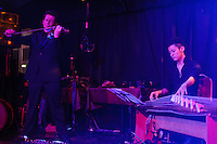 Paul Lazar and Kiyoshi Ibukuro of Les Oiseaux Noirs Caberet performing in Roppongi, Zero Hour club, Tokyo, Japan, June 27, 2012. The group formed for just four performances in 2012 and mixed song, instrumental performance, pole dancing, tango and yoyo.
