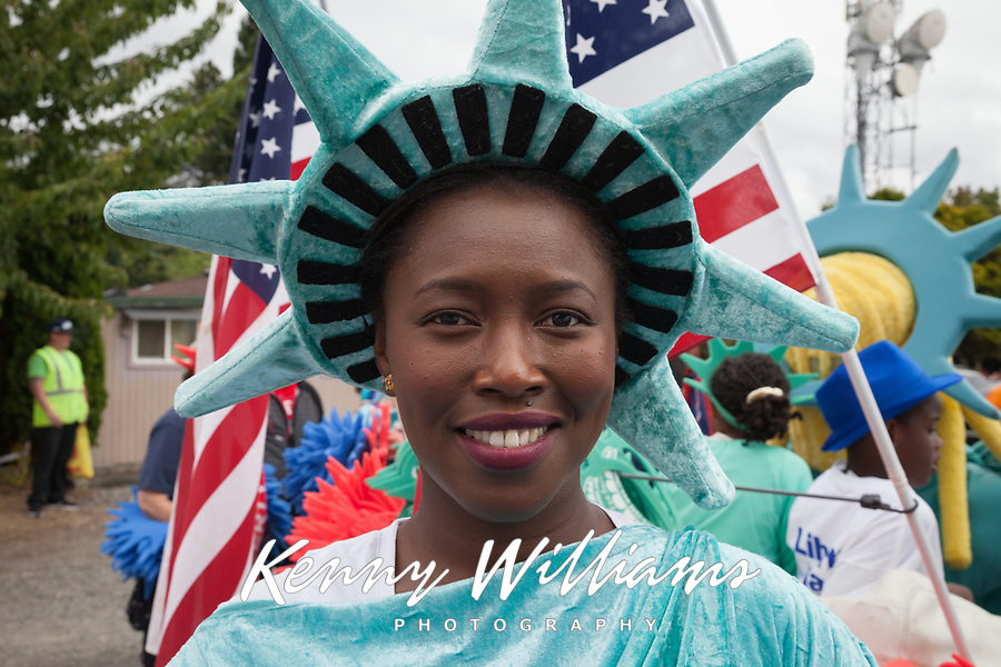 Woman wearing blue Statue of Liberty costume, Independence Day Parade 2016, Burien, Washington, USA.