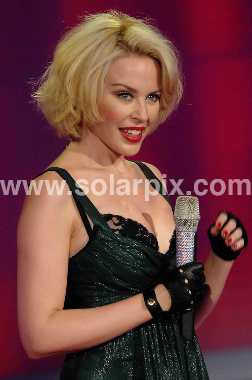 **ALL ROUND PICTURES FROM SOLARPIX.COM**.**WORLDWIDE SYNDICATION RIGHTS EXCLUDING UK & ITALY - NO PUBLICATION IN UK OR ITALY**.Kylie Minogue guests on an Italian TV show in Milan, Italy. 10 November 2007..This pic: Kylie Minogue..JOB REF: 8852 MXN       DATE: 10_11_2007.**MUST CREDIT SOLARPIX.COM OR DOUBLE FEE WILL BE CHARGED**.**ONLINE USAGE FEE GBP 50.00 PER PICTURE - NOTIFICATION OF USAGE TO PHOTO @ SOLARPIX.COM**.**CALL SOLARPIX : +34 952 811 768 or LOW RATE FROM UK 0844 617 7637**