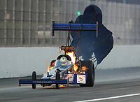 Nov 10, 2018; Pomona, CA, USA; NHRA top fuel driver Cameron Ferre has an engine fire during the Auto Club Finals at Auto Club Raceway. Mandatory Credit: Mark J. Rebilas-USA TODAY Sports