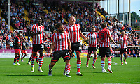 Lincoln City's Michael Bostwick celebrates scoring his sides second goal with team-mates John Akinde, left, and Harry Anderson<br /> <br /> Photographer Chris Vaughan/CameraSport<br /> <br /> The EFL Sky Bet League Two - Lincoln City v Swindon Town - Saturday 11th August 2018 - Sincil Bank - Lincoln<br /> <br /> World Copyright &copy; 2018 CameraSport. All rights reserved. 43 Linden Ave. Countesthorpe. Leicester. England. LE8 5PG - Tel: +44 (0) 116 277 4147 - admin@camerasport.com - www.camerasport.com