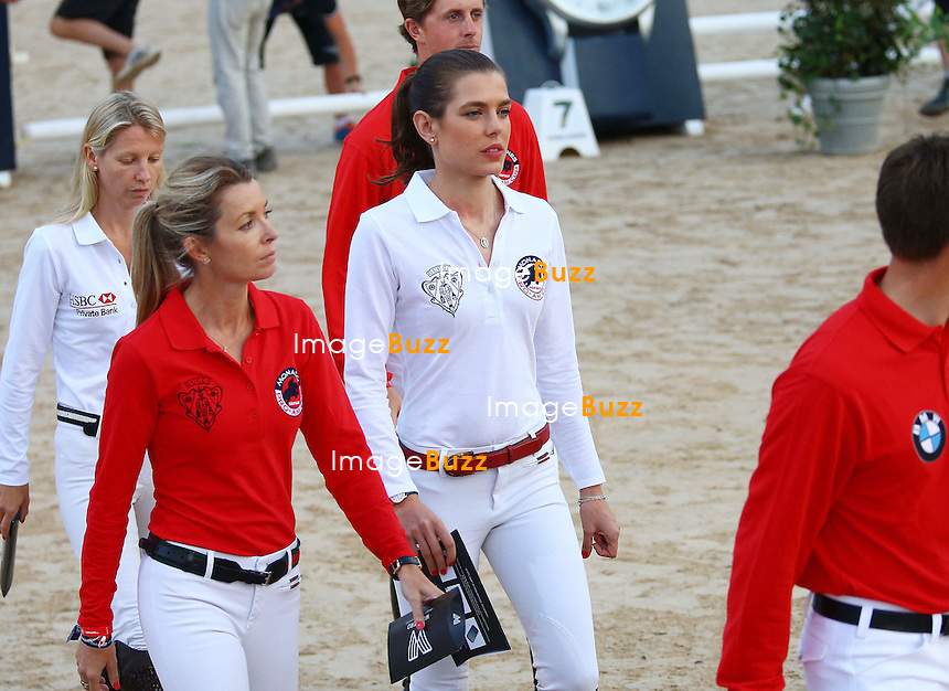 Charlotte Casiraghi and Edwina Tops-Alexander of Gucci team attend the Longines Pro-Am Cup Monaco 2014 during the International Monte-Carlo Jumping at Port Hercule on June 27, 2014 in Monaco, Monaco.