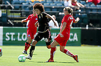 Eriko Arakawa (30) dribbles past Cat Whitehill (4). FC Gold Pride defeated Washington Freedom 3-2 at Buck Shaw Stadium in Santa Clara, California on August 1, 2009.
