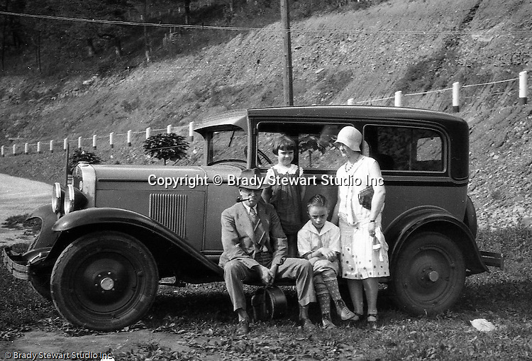 Fayette County PA:  Stewart family taking a break off Route 40 on the way to vacation and camp at Youghiogheny Lake - 1929. Stewart's traveling in a 1928 Chevrolet AB National Coach