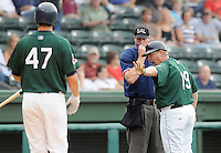July 5, 2009: Manager Kevin Boles (19) of the Greenville Drive tells Kade Keowen (47) to stay away as he argues with home plate umpire Joel Myers in a game against the Savannah Sand Gnats at Fluor Field at the West End in Greenville, S.C. Both Keowen and Boles were tossed from the game. Photo by: Tom Priddy/Four Seam Images