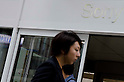 May 10, 2012, Tokyo, Japan - Japanese workers are walking in front of the Sony Building in Ginza, Japan. Sony Corp. reports an annual net loss of 457 billion yen (approximately $5.7 billion US Dollars) in FY 2011. This is Sony's fourth year in a row of remaining in red, however, the company expects to return to net profit in FY 2012. (Photo by Yumeto Yamazaki/AFLO)