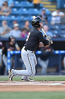Kannapolis Intimidators center fielder Hunter Jones (9) swings at a pitch during a game against the Asheville Tourists on May 19, 2015 in Asheville, North Carolina. The Tourists defeated the Intimidators 7-3. (Tony Farlow/Four Seam Images)