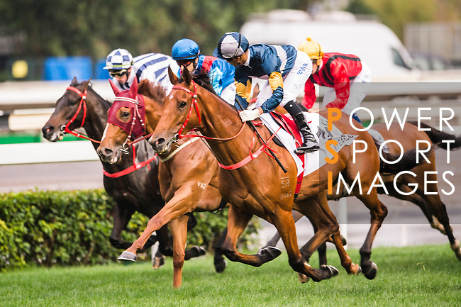 Jockey Karis Teetan (blue/white cap) riding My Darling and jockey Joao Moreira riding Rapper Dragon (2nd from left) compete during the 2017 BMW Hong Kong Derby Race at the Sha Tin Racecourse on 19 March 2017 in Hong Kong, China. Photo by Marcio Rodrigo Machado / Power Sport Images