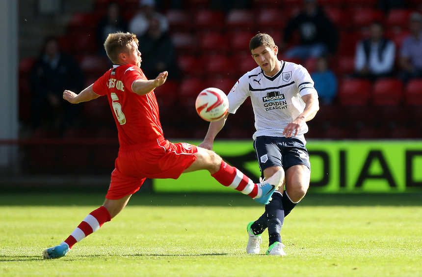 Preston North End's John Mousinho in action with Walsall's Nicky Featherstone..Football - npower Football League Division One - Walsall v Preston North End - Saturday 22nd September 2012 - Banks's Stadium - Walsall..