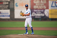 Ogden Raptors starting pitcher Orlandy Navarro (23) gets ready to deliver a pitch during a Pioneer League game against the Great Falls Voyagers at Lindquist Field on August 23, 2018 in Ogden, Utah. The Ogden Raptors defeated the Great Falls Voyagers by a score of 8-7. (Zachary Lucy/Four Seam Images)