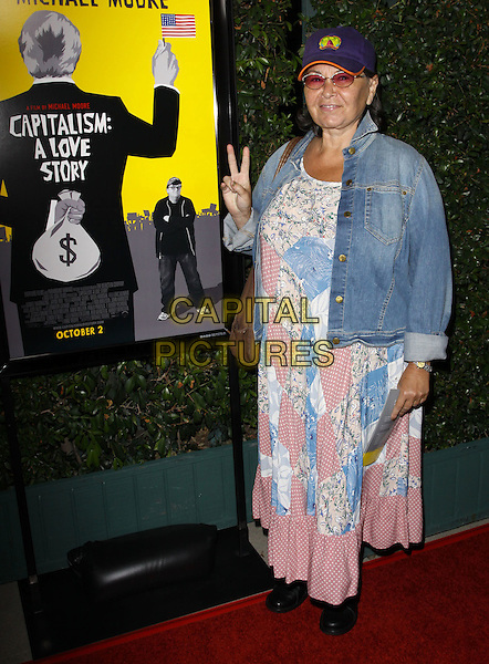 """ROSEANNE BARR.""""Capitalism: A Love Story"""" Los Angeles Premiere held At AMPAS Samuel Goldwyn Theater, Beverly Hills, California, USA..September 15th, 2009.full length jean jacket white blue pink pattern dress boots baseball cap hat hand v peace sign .CAP/ADM/KB.©Kevan Brooks/AdMedia/Capital Pictures."""