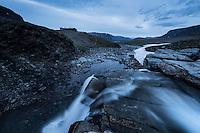 Waterfall flows near Tjäktja hut, Kungsleden trail, Lapland, Sweden