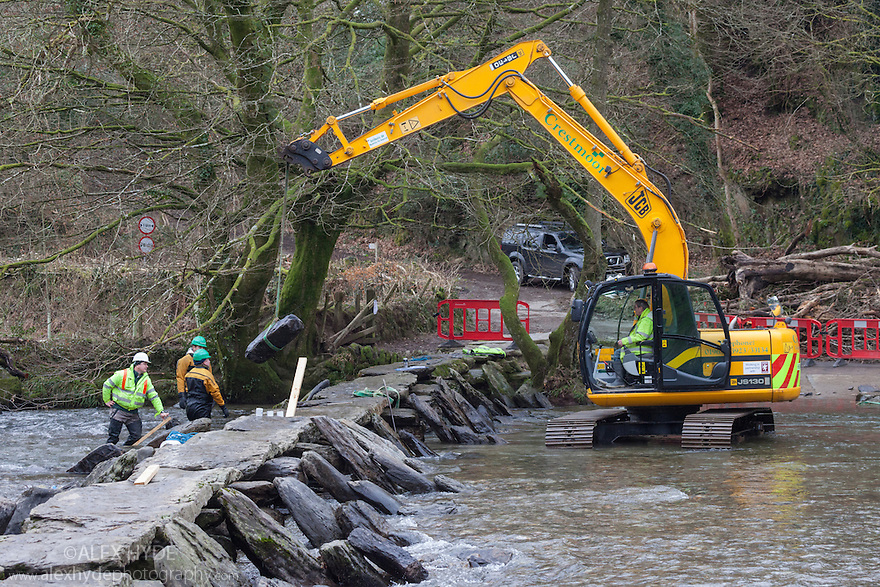 Tarr Steps, and ancient monument, being repaired following flooding. Exmoor National Park, Somerset, UK. February 2013.
