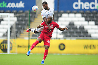 Marc Guehi of Swansea City vies for possession with Benik Afobe of Bristol City during the Sky Bet Championship match between Swansea City and Bristol City at the Liberty Stadium in Swansea, Wales, UK. Saturday 18 July 2020