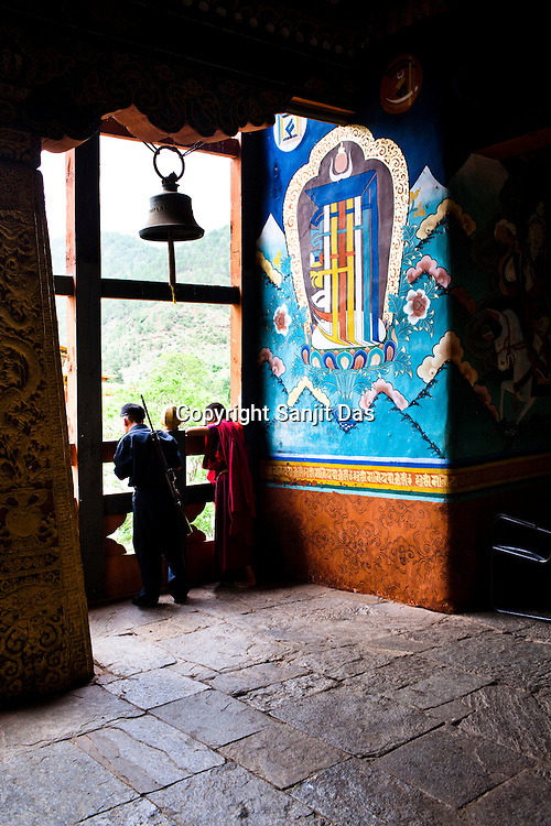 A lama and an armed policeman seen standing inside the Punakha Dzong in Punakha, the older capital of Bhutan. Punakha is the administrative centre of Punakha dzongkhag, one of the 20 districts of Bhutan. Photo: Sanjit Das/Panos