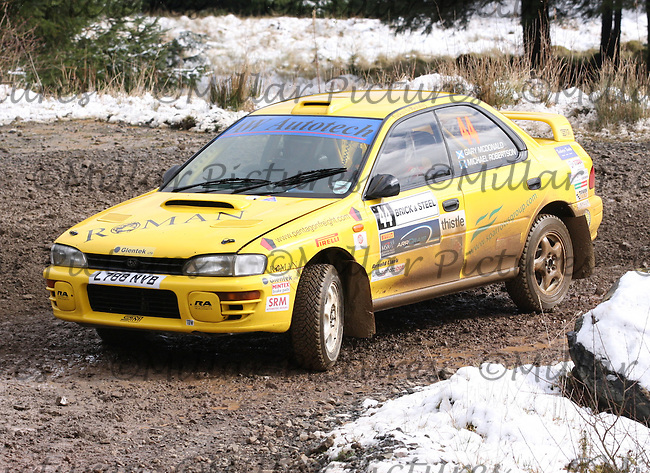 Michael Robertson - Gary McDonald in a Subaru Impreza at Junction 6 on Special Stage 1 Riccarton on the Brick & Steel Border Counties Rally 2014, Round 2 of the RAC MSA Scottish Rally Championship sponsored by ARR Craib Transport Limited and other championships  and organised by Whickham & District and Hawick & Border Car Clubs and based in Jedburgh and held in Kielder Forest on 22.3.14.