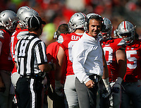 Ohio State Buckeyes head coach Urban Meyer jokes with referees during the first quarter of the NCAA football game at Ohio Stadium in Columbus on Sept. 12, 2015. (Adam Cairns / The Columbus Dispatch)
