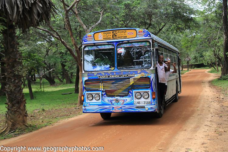 Colourful Lanka Ashok Leyland bus, Polonnaruwa, North Central Province, Sri Lanka, Asia people waving