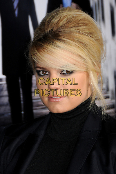 """JESSICA SIMPSON.""""Extraordinary Measures"""" Los Angeles Premiere held at Grauman's Chinese Theatre, Hollywood, California, USA..January 19th, 2010.headshot portrait black high collar beehive teased hair big sweeping fringe.CAP/ADM/BP.©Byron Purvis/AdMedia/Capital Pictures."""