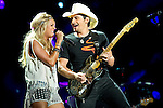 Carrie Underwood and Brad Paisley perform at LP Field during Day Four of the 2013 CMA Music Festival in Nashville, Tennessee.