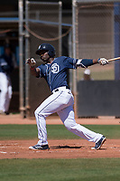 San Diego Padres shortstop Ruddy Giron (2) follows through on his swing during an Extended Spring Training game against the Colorado Rockies at Peoria Sports Complex on March 30, 2018 in Peoria, Arizona. (Zachary Lucy/Four Seam Images)