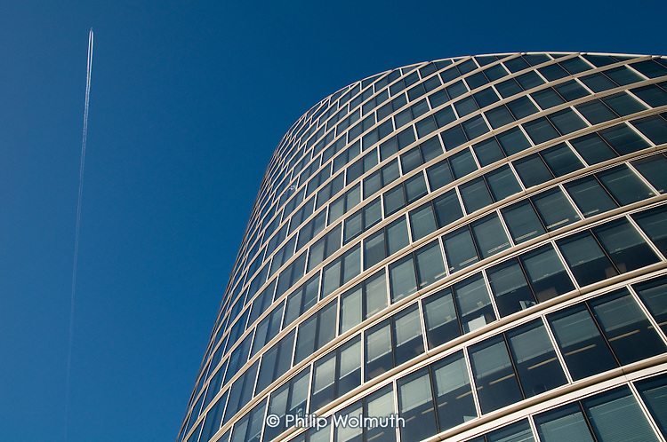 A jet leaves a vapour trail over the Moorhouse office development, designed by architects Foster and Partners, at the junction of Moorgate and London Wall, City of London.