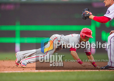 28 April 2016: Philadelphia Phillies second baseman Cesar Hernandez dives safely back to first during the 5th inning against the Washington Nationals at Nationals Park in Washington, DC. The Phillies shut out the Nationals 3-0 to sweep their mid-week, 3-game series. Mandatory Credit: Ed Wolfstein Photo *** RAW (NEF) Image File Available ***