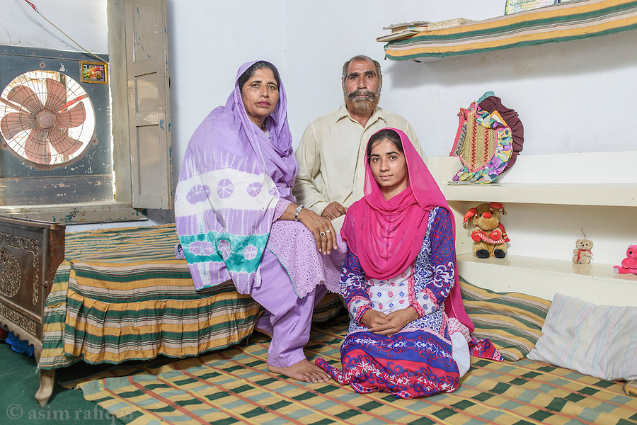 Appa Badrunnisa, Leader and local organiser of the women's wing of landless peasant movement (the Anjuman-e-Mazareen, Kalyana Estate, Chak 28, Okara. The photograph shows her  with her husband and her eldest daughter.