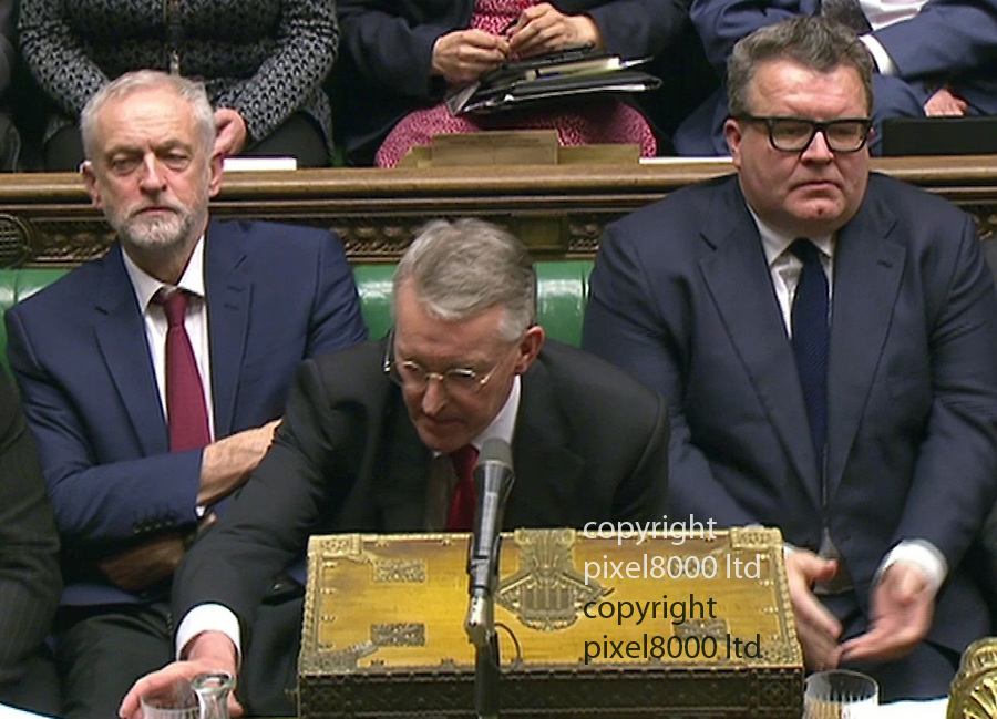 pic shows Syria Debate<br /> Hilary Benn sits down uncomfortably next to Jeremy Corbyn and Tom Watson after a round of applause for his final speech<br /> <br /> <br /> Picture by Pixel8000 07917221968