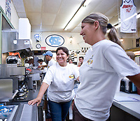 Marta Ortega and Holly Brown work behind the counter at Sutton's Drugstore.